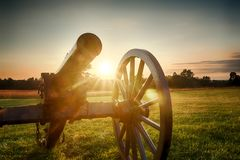Sunset Canon. A canon sits in the foreground during a sunset at Manassas Battlefield royalty free stock photos