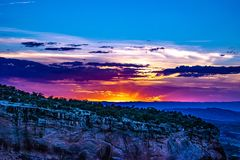 Sunset through the Canyon Gorge on the monuments in Grand Junction, Colorado. Sunset through the Canyon gorge on the monuments in Colorado National Monument in royalty free stock image