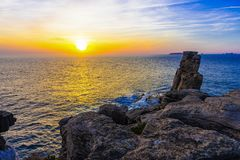 Sunset at the Cape Espichel, Peniche, Portugal. Colorfull Sunset at Cape Espichel, Peniche, Portugal background horizon landscape nature sky summer sunlight stock photography