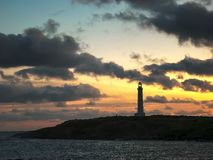 Sunset at cape leeuwin lighthouse in west australia. Sunset at west australia`s cape leeuwin lighthouse, situated at the most south westerly tip of australia royalty free stock images