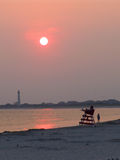 Sunset at Cape May. Cape May lighthouse, watch tower and the setting sun Stock Images
