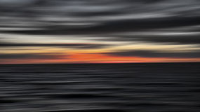 Sunset at Cape May, New Jersey. Abstract of sun setting over the Atlantic Ocean at Cape May, NJ Royalty Free Stock Images