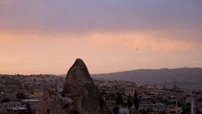 Sunset in Cappadocia with its rocky terrain. In the summer stock video footage