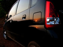 Sunset on the Car. The sunset in tropical India reflected on a black car Royalty Free Stock Photography