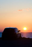 Sunset Car. A car parked on a beach at sunset Stock Photography
