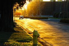 Sunset, car, fire hydrant... Stock Image