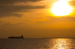 Sunset. Cargo container ship sailing at the sunset Stock Images