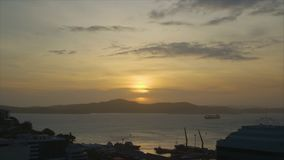 A sunset from a cargo pier. A timelapse shot of the sunset. A cargo pier is in the shot stock video