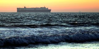 Sunset Cargo Ship Royalty Free Stock Images