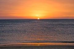 Sunset on caribbean beach stock photo