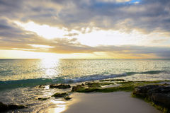 Sunset on a caribbean beach Royalty Free Stock Image