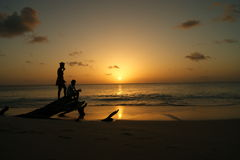 Sunset on a Caribbean island. Kids playing in the sunset on Antigua, Caribbean Royalty Free Stock Photos
