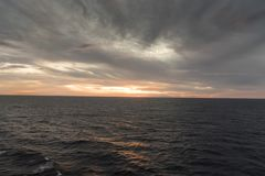 Sunset in the Caribbean from Island Princess. The Caribbean is a region of The Americas that consists of the Caribbean Sea, its islands and the surrounding royalty free stock photo