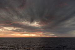 Sunset in the Caribbean from Island Princess. The Caribbean is a region of The Americas that consists of the Caribbean Sea, its islands and the surrounding royalty free stock photos