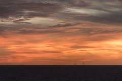Sunset in the Caribbean from Island Princess. The Caribbean is a region of The Americas that consists of the Caribbean Sea, its islands and the surrounding royalty free stock image