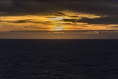 Sunset in the Caribbean from Island Princess. The Caribbean is a region of The Americas that consists of the Caribbean Sea, its islands and the surrounding stock photography