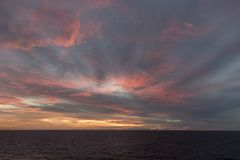 Sunset in the Caribbean from Island Princess. The Caribbean is a region of The Americas that consists of the Caribbean Sea, its islands and the surrounding royalty free stock images