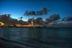 Sunset on the Caribbean Sea. Buildings in the distance Stock Photo