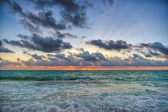 Sunset on the Caribbean Sea. Buildings in the distance Stock Images