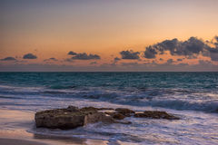 Sunset on the Caribbean Sea. Buildings in the distance Royalty Free Stock Images