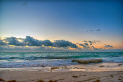 Sunset on the Caribbean Sea. Buildings in the distance Royalty Free Stock Photography
