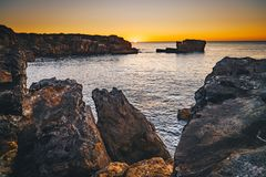Sunset in Cascais, Portugal at Boca del Inferno famous spot for. Watching sunsets in Cascais, Lisbon district, Portugal Royalty Free Stock Image