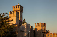 Crenellated Italian castle at sunset Sirmione Royalty Free Stock Image