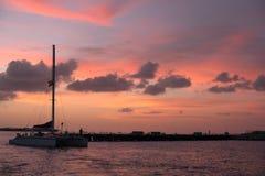 Sunset with Catamaran Royalty Free Stock Photos
