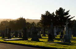 Sunset at the Cemetery. A sunset at an old cemetery in Colma, California Royalty Free Stock Photos