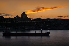 Sunset and the Chateau Frontenac Quebec City. Sunset on the Saint Lawrence seaway with a boat and the Chateau Frontenac in Quebec City as a background stock images