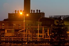 Sunset and chemical plant Stock Images