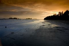 Sunset on Chesterman Beach. Sunset over a beach Royalty Free Stock Image