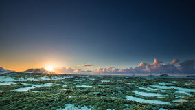 Sunset on Christmas Eve. In Iceland with a moss grown and snow covered lava field in the foreground royalty free stock image