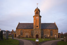 Sunset church. Church in Elie, East Neuk, Fife, Scotland struck by setting sun. Building erected in 1639 Royalty Free Stock Photos