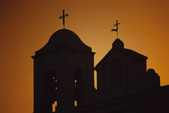 Sunset church. Two crosses against the setting sun in Greece royalty free stock images