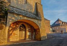 Sunset at the church entrance. Bozouls, Midi Pyrenees, France - September 21, 2017: Sunset at the entrance of an old solitary church Royalty Free Stock Photos