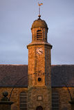 Sunset church steeple. Church in Elie, East Neuk, Fife, Scotland struck by setting sun. Building erected in 1639 Royalty Free Stock Photo