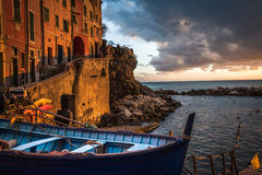 Sunset at Cinque Terre italy. Sunset over the sea at Cinque Terre Italy with boat and buildings in the foreground Stock Photography