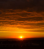 Sunset. In the ciry with clouds Stock Images