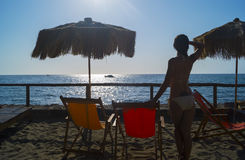 Sunset on Citara beach, Ischia. Girl is looking on sunset, Citara beach, Ischia Royalty Free Stock Photos