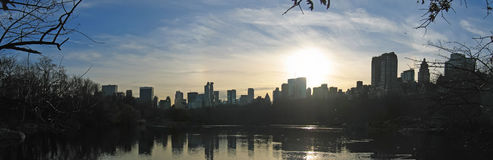 Sunset on the city. From central park above the lake - New York Stock Image