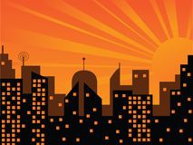 Sunset in the city. City buildings in the light of sunset. Vector is also available Stock Images