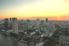 Sunset in the City. Modern building at Chaophraya riverside Royalty Free Stock Images