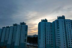 Sunset in the city on the background of high-rise.  royalty free stock photography