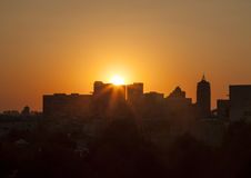 Sunset in the city. Beautiful red sunset in the city among buildings Stock Images