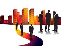 Sunset city business. A group of drawn businessmen in silhouette in contrast against a city scape Stock Photos