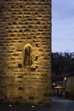 Sunset city lights and symbols of a historical city like old tow. Er and crucifix in south germany autumn november evening near city of stuttgart and munich royalty free stock photos