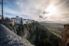 Sunset in the city of Ronda, in Spain. City of Ronda, Malaga, Spain. Walk through Plaza de Toros and the old streets. Sunset view on the bridge New stock image