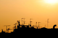 Sunset on city roofs skyline Royalty Free Stock Images