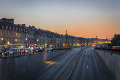Sunset city scene. Sunset at Richelieu Quay in Bordeaux Royalty Free Stock Photography